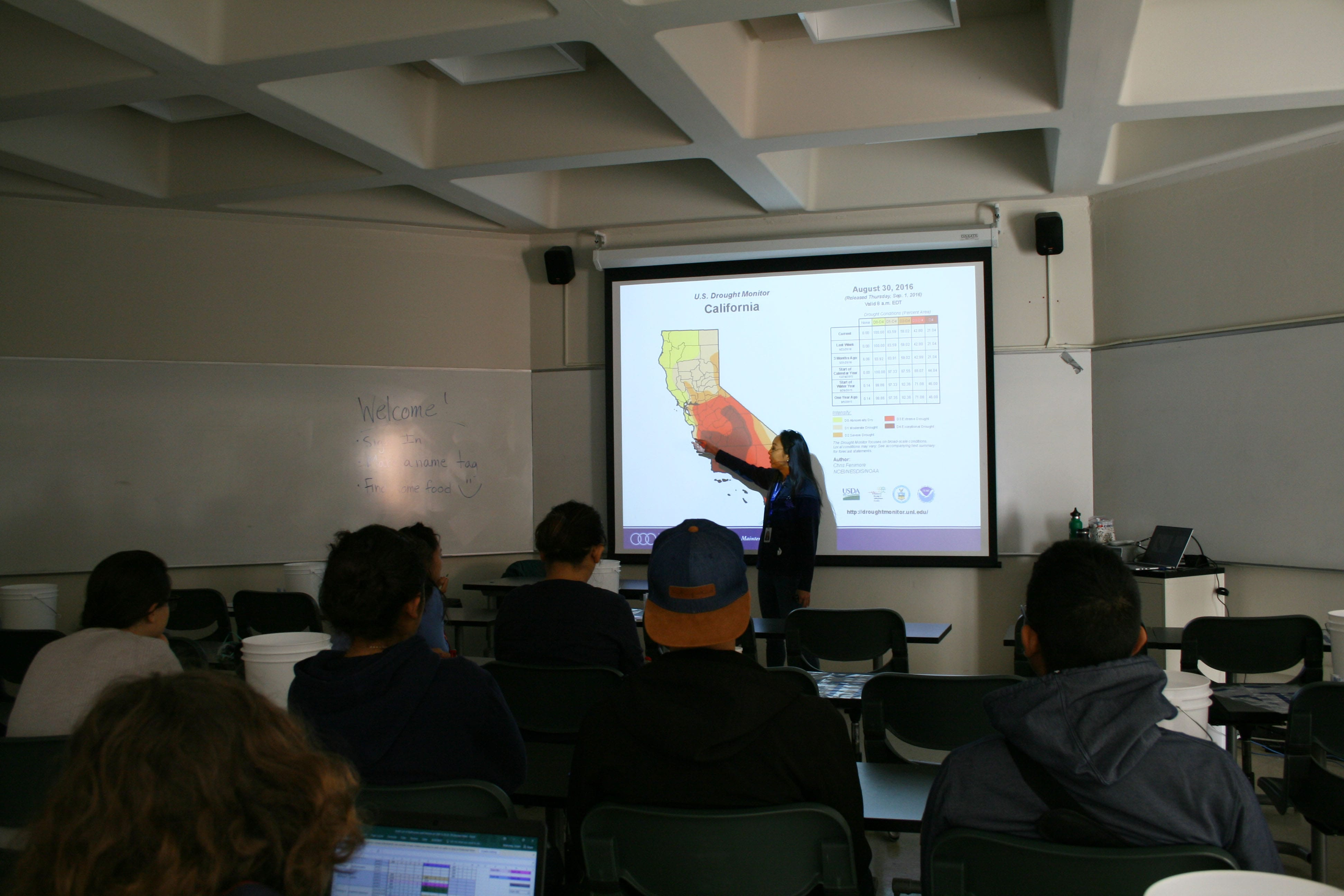 Presenter pointing at a heat map of california